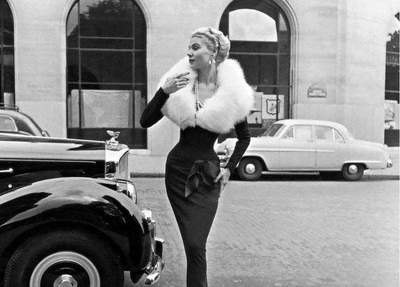 Dior classic elegance: refined model 1940-1960-ies on the streets of Paris
