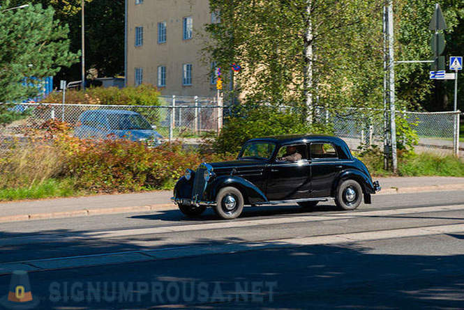 Old cars on the streets of the Finnish